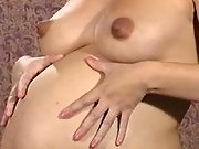 Pregnant beauty caresses her paunch